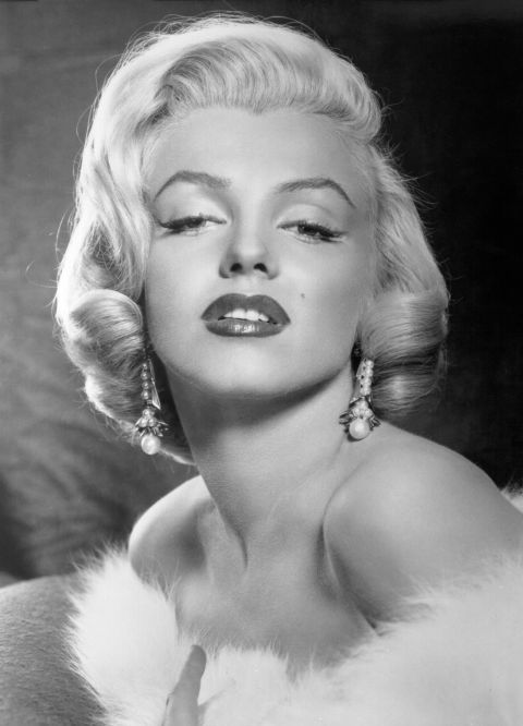 To make her lips appear fuller, Monroe would have her makeup artist apply 5 different shades of lipstick and gloss to create dimension. Darker reds went on the outer corners, while lighter hues were brushed on the middle of the lips.<br /><br /><br /><br /><br /><br /><br /><br />