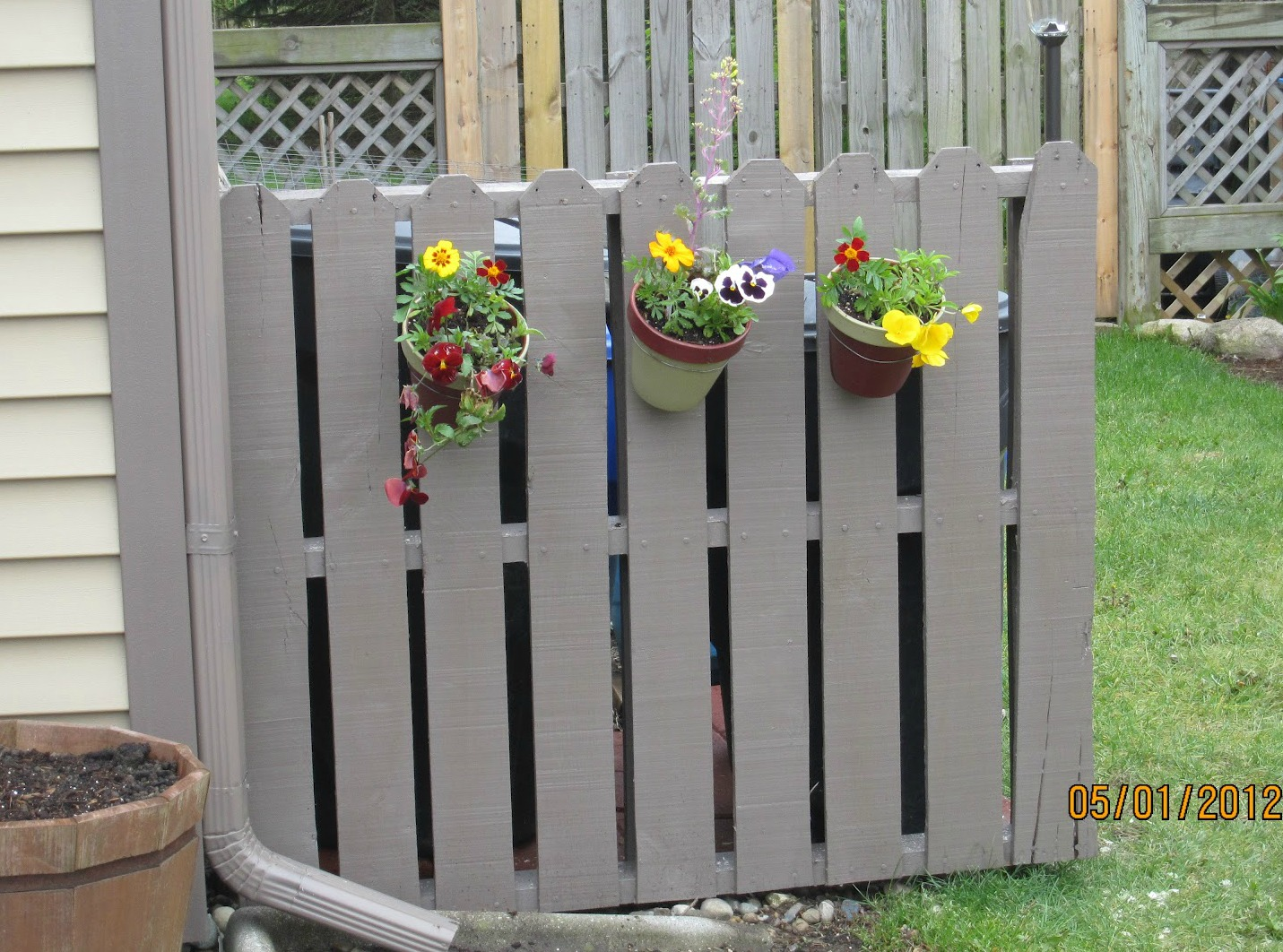 how to hide a trash can disguise ugly garbage can - Garden Ideas To Hide Fence