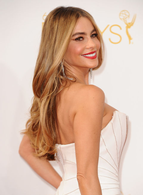 Long mermaid hair is always wonderful, but going golden blonde takes your hair from simply pretty to Sofia Vergara-level sexy.