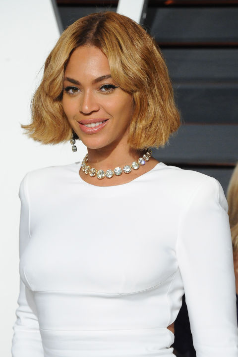 If you have a warm caramel skin tone, complement your complexion with a deep honey blonde like Beyonce's.