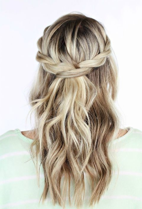 A pretty spin on the classic half-up half-down bridal hairstyle, this look is versatile and easy to create on your own. Get the tutorial at TwistMePretty »