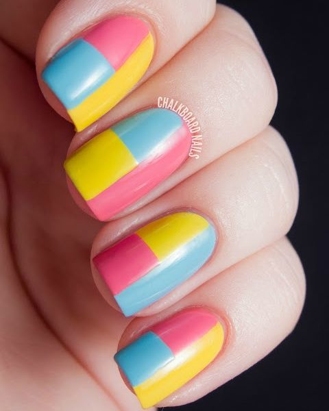 If you want to play with multiple shades that work day or night, go for this color blocked nail art. If these summer brights are too wild for you, trade them in for three shades that all belong to the same color family — for example, baby blue, cerulean, and navy. See more at Chalkboard Nails »