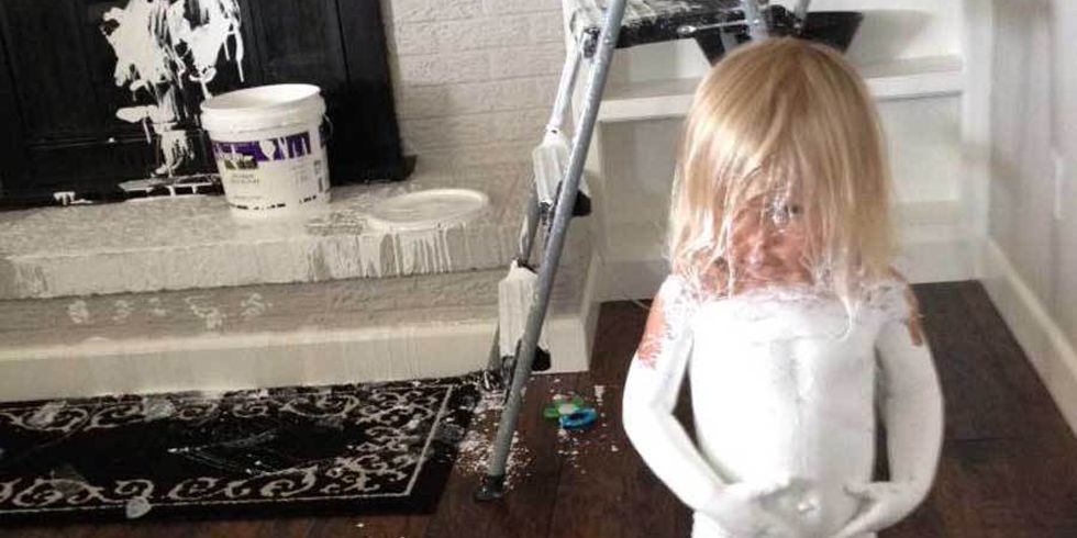 Little Girl Covers Herself In Paint Leaves Footprints All