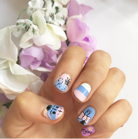 Who knew a Winnie the Pooh character could be so cute on your nails? The pastel shades keep this design sweet, while the alternating patterns give it a touch of sophistication.