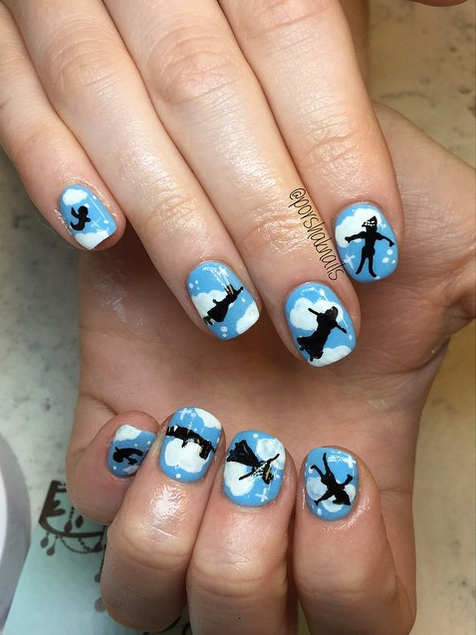 Every time you look at this magical manicure, you'll think happy thoughts.