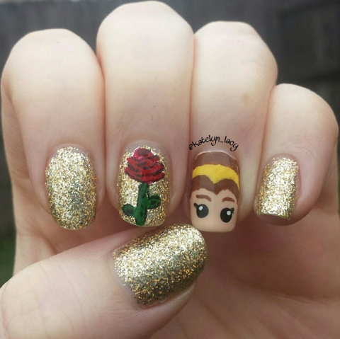 There's nothing beastly about this glittery design. We especially love the rose and princess accent nails.