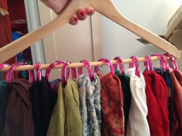 Don't let your scarves take up valuable drawer space. Instead, throw shower curtain hooks on a hanger (we love these cute pink ones) and let your scarves dangle through for a no-wrinkle storage solution. Get the tutorial at From the Desk ?