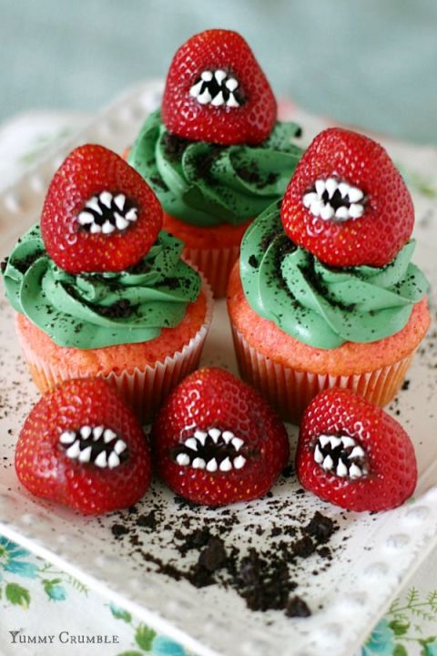 first of all these cupcakes are pink second these monster strawberries are too