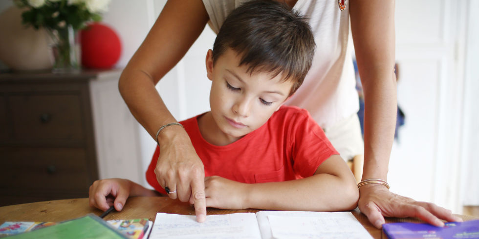 why you shouldn t help your kids their math homework study  mother helping her son math homework