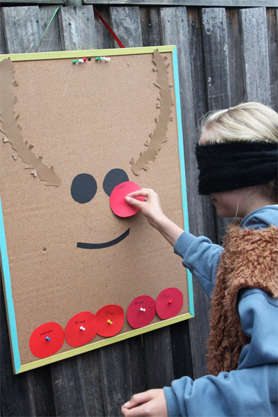 A corkboard turns into a cute reindeer face with some construction paper eyes and antlers. Write each player's name on a handmade red nose, and have them pin it to the board while blindfolded.  See more at Living On the Crafty Side of Life »