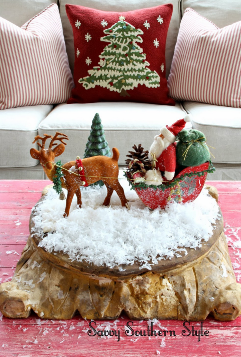 A miniature display of Santa Claus and his reindeer looks especially fun on some fake snow.  See more at Savvy Southern Style »