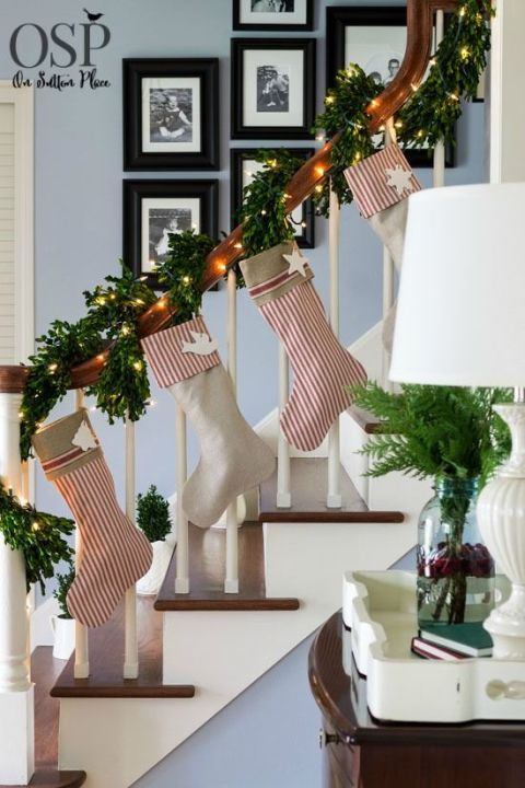 Forget the fireplace           —   this blogger hung her stockings along her stairs, and highlighted the collection with thick garland and twinkle lights. See more at On Sutton Place »