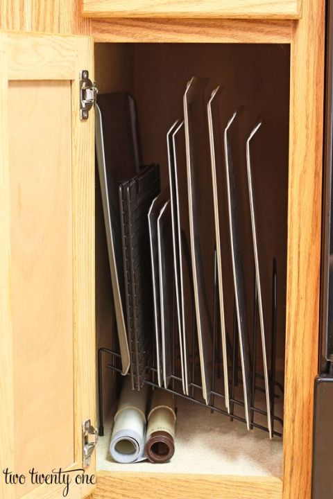 Have you ever stacked your cookie sheets in a cabinet only to have them slide all over the place when you open the door? Use an office paper sorter to store them vertically and avoid future spillage.<br /> See more at Two Twenty One »<br />