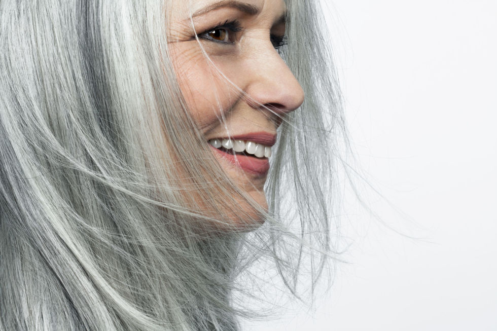 "Gray hair doesn't have to add 10 years — as long as you keep the color vibrant. ""Yellowing gray hair is as bad as yellowing teeth,"" says Howse. Prevent silver strands from dulling your features with products that contain shine enhancers and UV filters. On hair that's more than 50% gray, use a shampoo with blue or violet undertones to neutralize yellow. If yellow tones cling tenaciously, as they tend to on 100% white hair, Howse recommends coloring hair a light shade of blond to take the aging effect away."