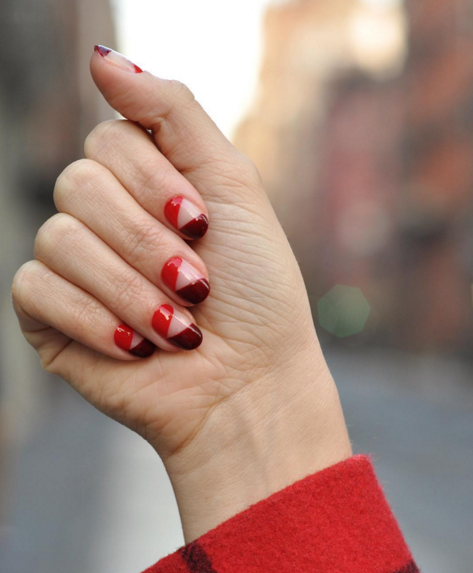 Experiment with negative space for a cool, modern look by using two shades, keeping an empty diagonal gap between them. Pick similar colors like red and scarlet for a coordinated look or opt for contrasting hues to achieve a less-than-subtle style. See more at Paintbox Nails »