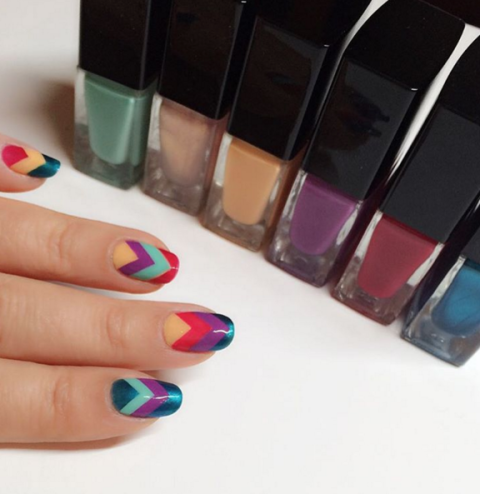 Elongate short nails and make use of all your favorite polishes with a cool, '70s-inspired chevron design that stacks up different shades. See more at Casey Nails' Instagram »