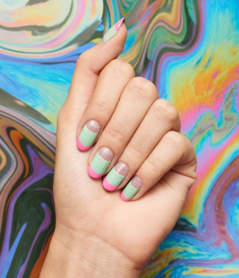 Minty green middles, tickle-me-pink tips, and negative space moons make this bright, bold manicure a winner all around.  See more at Paintbox Nails »
