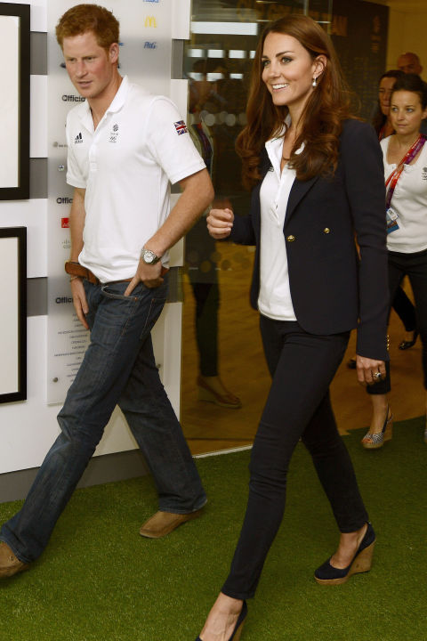 August 9, 2012 &mdash; During the London 2012 Olympic Games, Kate and her brother-in-law Harry visited athletes at the Team GB House in the Westfield Centre wearing similar outfits of jeans and white polo shirts. Kate accessorized her look with a pair of cork wedges.