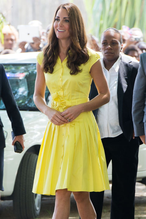 September 17, 2012 &mdash; The Duchess wore another yellow dress&mdash;this one is by the brand Jaeger&mdash;for a visit to a village in the Solomon Islands.