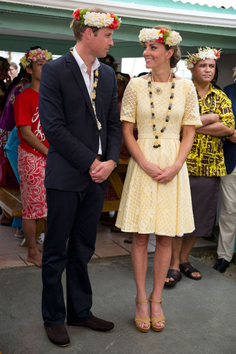 September 18, 2012 — During the Diamond Jubilee tour of Singapore, Malaysia, the Solomon Islands and Tuvalu, Kate wore a lightweight eyelet dress in pale yellow with Stuart Weitzman wedges.