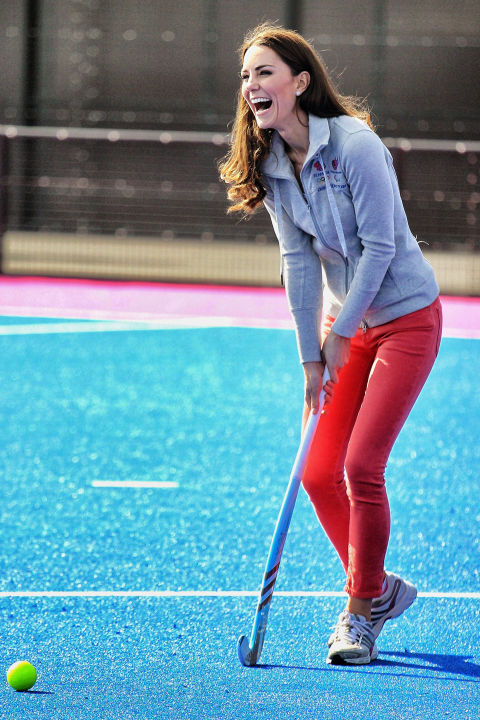 March 15, 2012 — Kate wore a pair of bright red skinny jeans with a gray sweatshirt and sneakers to play field hockey at the Riverside Arena in the Olympic Park in London.