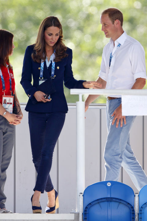 July 28, 2014 — Kate wore a double-breasted blazer with skinny jeans and Stuart Weitzman cork wedges to watch a hockey match at the Glasgow National Hockey Centre during the 20th Commonwealth Games.