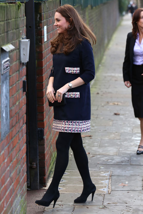 January 15, 2015 — While pregnant with Princess Charlotte, Kate wore this patterned black shift to officially name The Clore Art Room at Barlby Primary School.