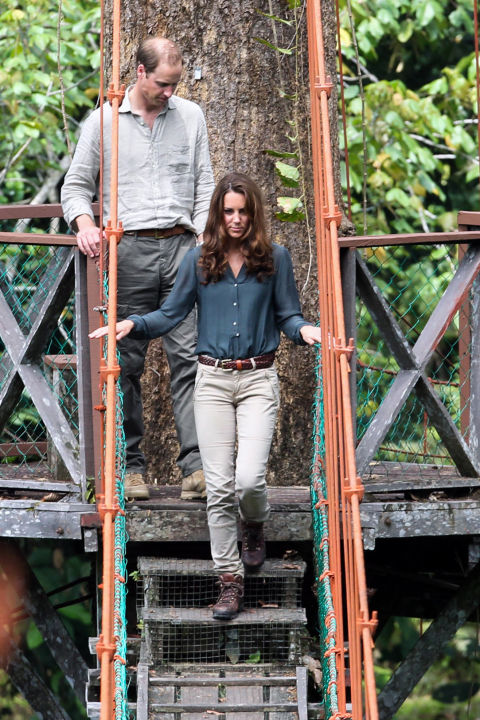 September 15, 2012 — Will and Kate managed to look comfy and polished in khakis and hiking boots while on a walk through the rainforest in Danum Valley on the island of Borneo.