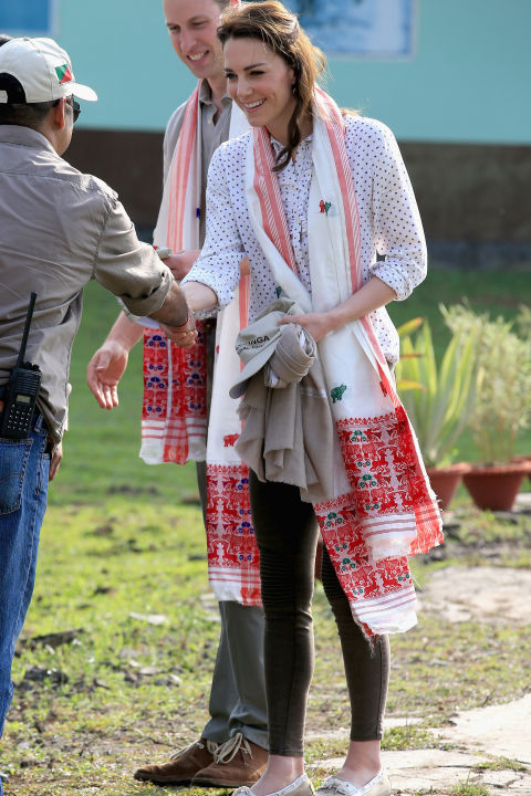 April 13, 2016 — As she and Will prepared to leave on a safari in India's Kaziranga National Park, the Duchess wore a polka dot button-down, dark skinny jeans and an embroidered scarf.