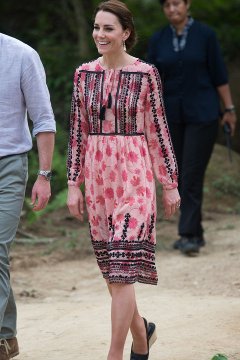 April 13, 2016 &mdash; Earlier on her trip to India and Bhutan, the Duchess chose a pink floral dress with black details from Topshop to visit to the Centre for Wildlife Rehabilitation and Conservation (CWRC) at Panbari reserve forest in Kaziranga to feed baby elephants.