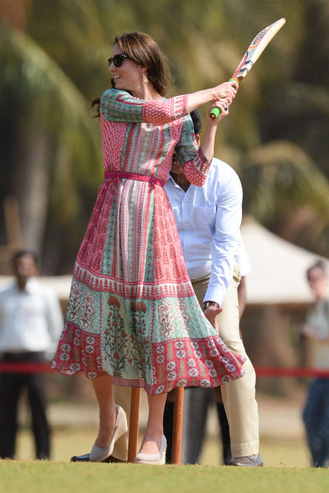 April 10, 2016 — The future queen showed off her cricket skills at Mumbai's recreation ground, the Oval Maidan, wearing a dress by Anita Dongre, a popular Indian designer, and beige wedges from Monsoon.