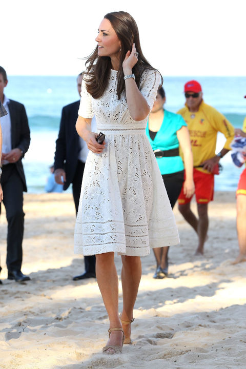 April 18, 2014 — During her and Prince William's tour of Australia, Kate wore a white eyelet dress by Australian designer Zimmermann with another pair of Stuart Weitzman wedges to an event at Manly Beach in Sydney.