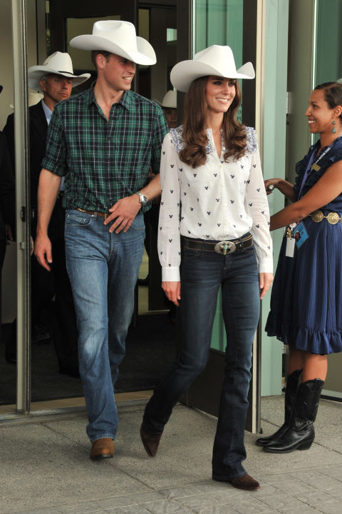 July 7, 2011 — Will and Kate wore matching white cowboy hats to the Calgary Stampede on their royal tour of Canada. Kate completed her cowgirl look with a white button-up, blue jeans, cowboy boots and a belt with turquoise details.