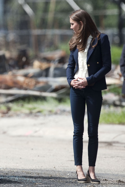 July 7, 2011 — While in Canada, Kate relied on her casual uniform of skinny jeans, a navy blazer and slingback wedges.