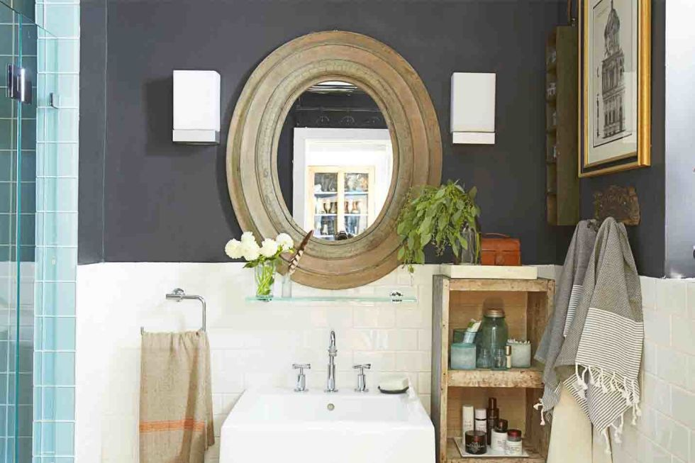 a floating glass shelf below the mirror adds storage seamlessly next to the sink