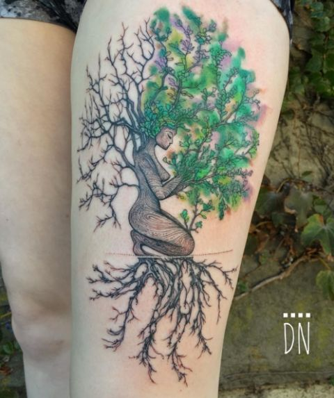 Another stunning Dino Nemec design, this tattoo features a tree figure kneeling as a blend of ivy, jade and pear colors make up its