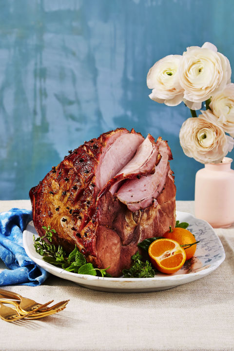 The secret to this fancy ham's undeniably sweet flavor? A good ol' can of fizzy root beer.