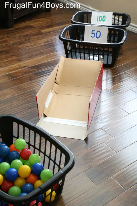 Dump out the laundry baskets for an indoor arcade game. Launched off a cardboard ramp, plastic balls score major points withbored kiddos.  Get the tutorial at Frugal Fun for Boys and Girls»