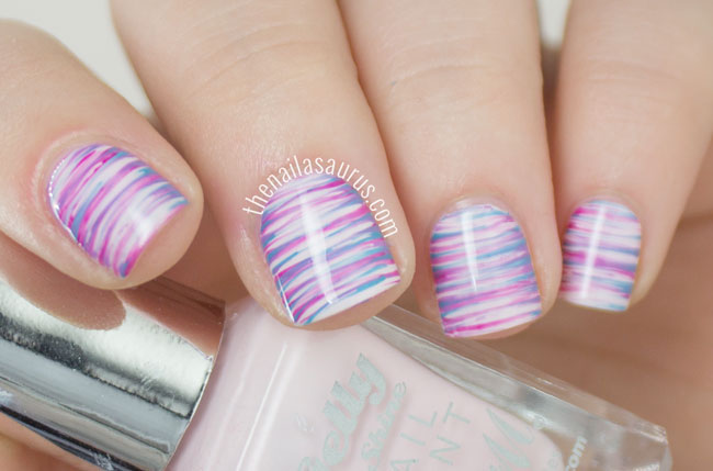 Would you believe this triple-colored design is pretty easy to accomplish? All you need: three colors and a fan brush! Vary the shades to fit any other occasion — or just to match your outfit. See more at The Nailasaurus »