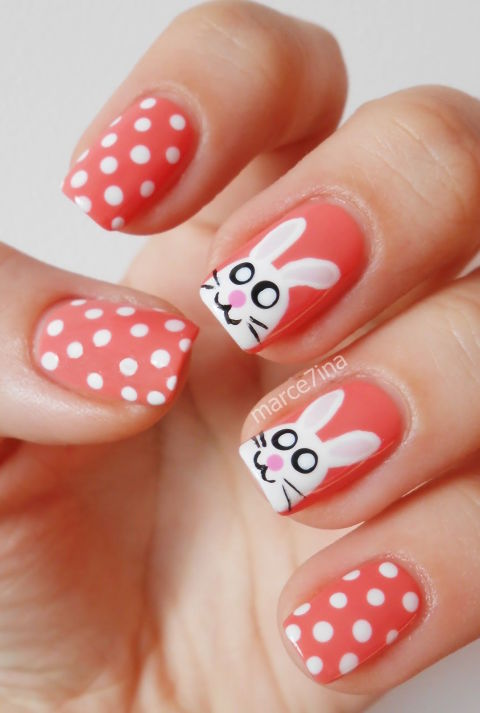 We gave you chicks, but we can't forget the big bunny, too! Paint these little guys on your middle and index fingers, then decorate the rest of your tips with cute polka dots. See more at Marce7ina »