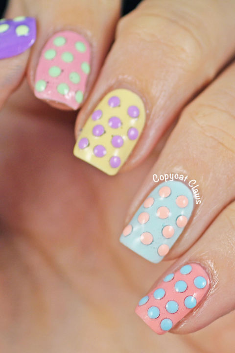 "Add a little texture to your typical polish with small ""studs"" in a contrasting color. Keep things in the pastel family to avoid this multidimensional mani looking too busy. See more at Copycat Claws »"
