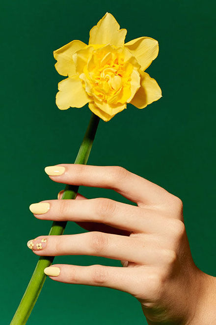 Tulips, daffodils and sunshine – some of Spring's best features are yellow. Represent that on your nails with this cheery yellow manicure, complete with mini bloom accents and make yellow an Easter neutral. See more on Paintbox »
