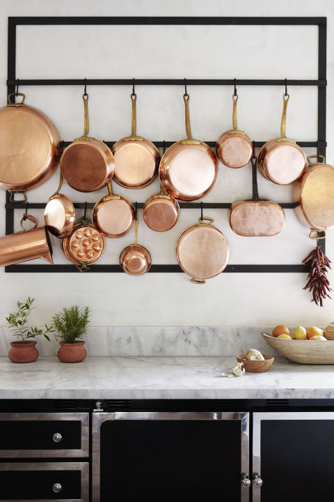 Let your copper cookware steal the show by mounting a rack and sturdy metal hooks