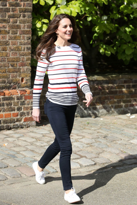 April 19, 2017 — Dressed down in jeans and a striped pullover, the Duchess laced up her favorite Supergas&nbsp;for a reception honoring London Marathon runners. The race is benefiting the young royals' mental health campaign, Heads Together, this year.