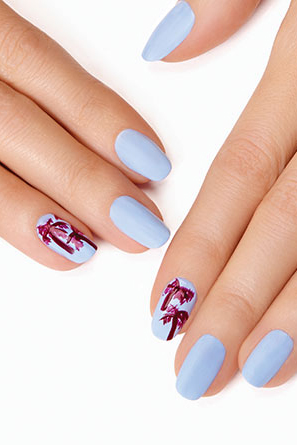 Palm tree nail art can look cartoonish, but when you use a delicate pastel base color and make your trees a chic shade of purple, they look more sophisticated and fun. See more at Essie »
