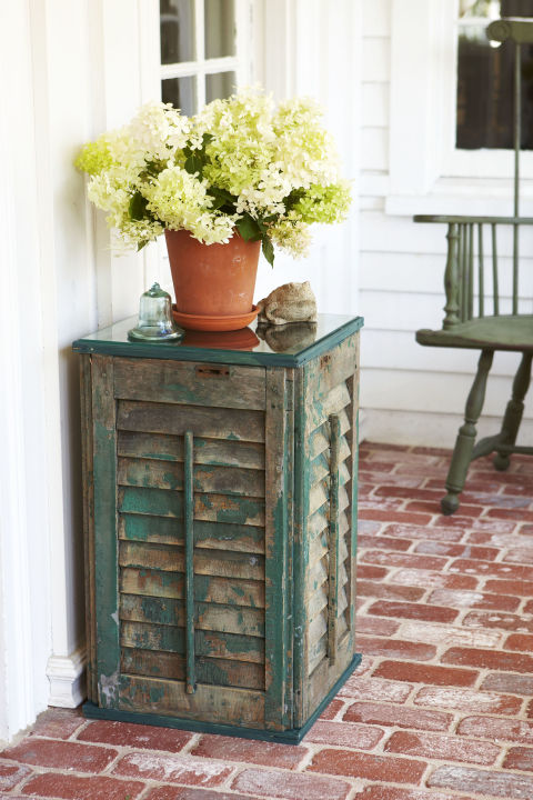 Skip painting and embrace aweathered finish for this tiny table. A set of rustic shutters provides the perfect base for a potted plant or a vase of blooms. Get the tutorial» What you'll need:shutters, $49 for a 2-pack, etsy.com