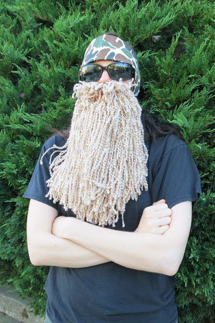 You don't need a giant self-grown beard to dress up as these mountain men — all this costume requires is a pair of sunglasses, a headband, and a tolerance for yarn going in your mouth.