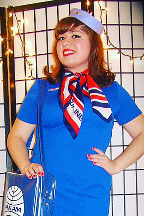 Got a solid shift dress in your closet? You're only a couple accessories and a sharp cat eye away from a '60s stewardess costume.