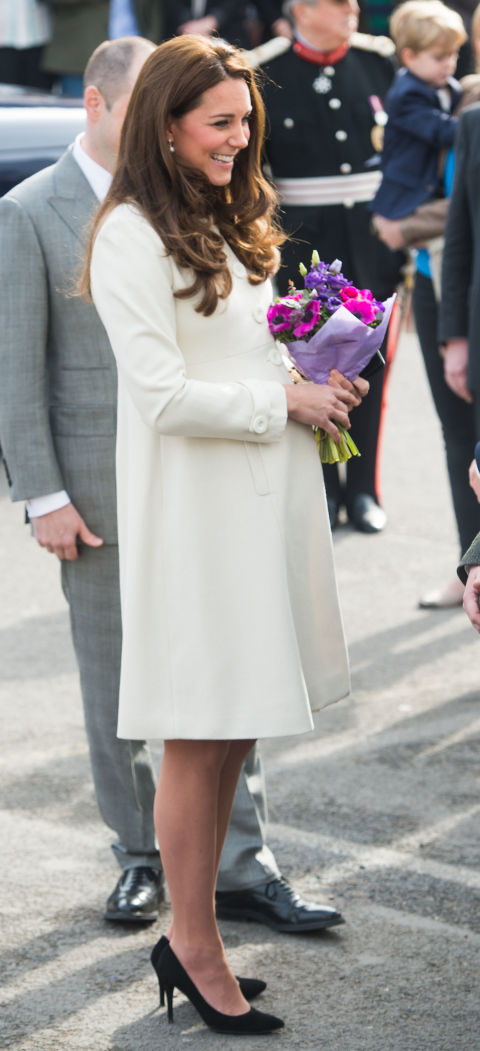 March 12, 2015&amp;nbsp;&mdash;&amp;nbsp;The Duchess of Cambridge went with an empire waist white coat to visit the set of Downton Abbey at Ealing Studios&amp;nbsp;in London, England.