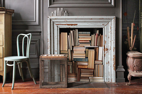 gray fireplace with books